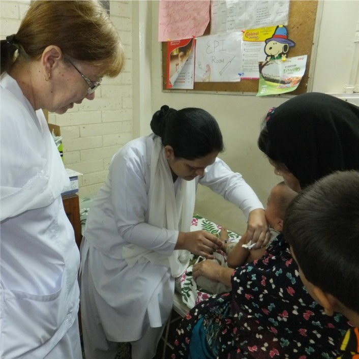 Missionary doctor overseeing the care being given to a child in the hospital.