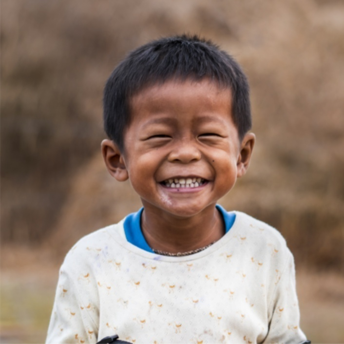 Little Cambodian boy smiling broadly