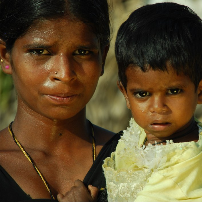 Head and shoulders image of a Sri Lankan mother and her young child