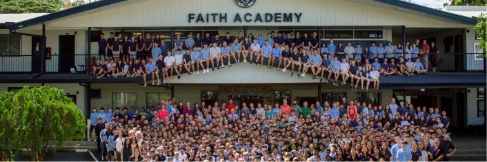 School body of Faith Academy posing outside the facility for a school picture.